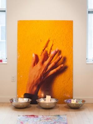 Bettina Werner's hand creating on a texturized salt crystal surface.